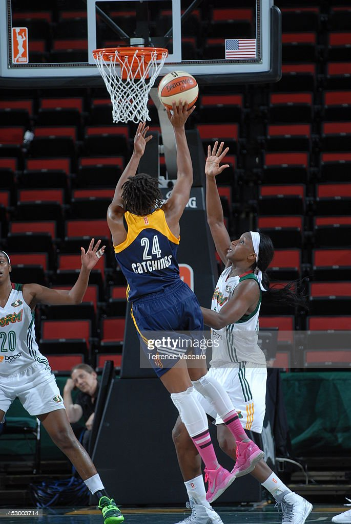 <a gi-track='captionPersonalityLinkClicked' href=/galleries/search?phrase=Tamika+Catchings&family=editorial&specificpeople=202220 ng-click='$event.stopPropagation()'>Tamika Catchings</a> #24 of the Indiana Fever shoots against the Seattle Storm on July 31,2014 at Key Arena in Seattle, Washington.