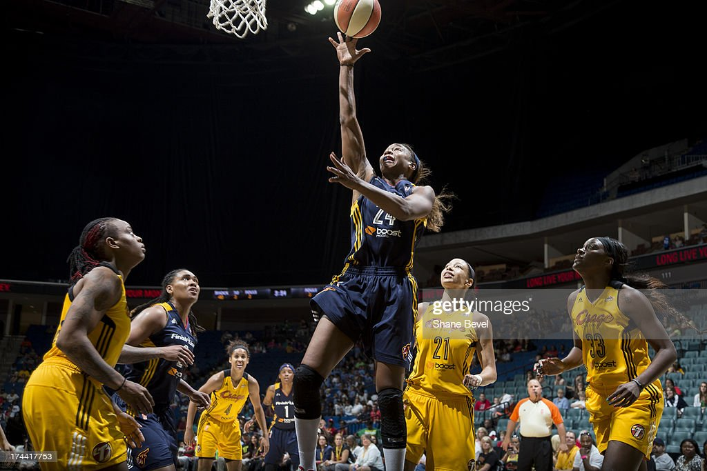 <a gi-track='captionPersonalityLinkClicked' href=/galleries/search?phrase=Tamika+Catchings&family=editorial&specificpeople=202220 ng-click='$event.stopPropagation()'>Tamika Catchings</a> #24 of the Indiana Fever shoots against the Tulsa Shock during the WNBA game on July 25, 2013 at the BOK Center in Tulsa, Oklahoma.