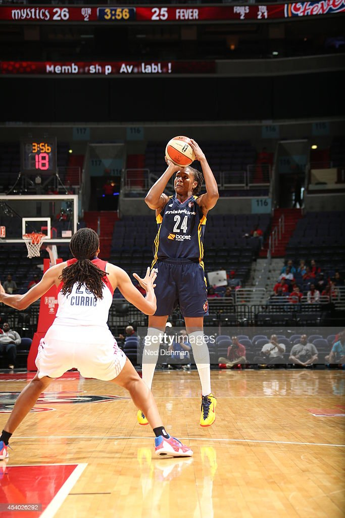 Tamika Catchings #24 of the Indiana Fever shoots the ball against Monique Currie #25 of the Washington Mystics in Game Two of the Eastern Conference Semifinals during the 2014 WNBA Playoffs on August 23, 2014 at the Verizon Center in Washington, DC.