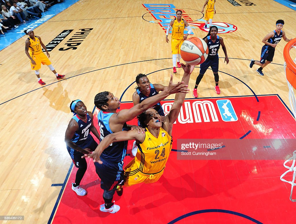 <a gi-track='captionPersonalityLinkClicked' href=/galleries/search?phrase=Tamika+Catchings&family=editorial&specificpeople=202220 ng-click='$event.stopPropagation()'>Tamika Catchings</a> #24 of the Indiana Fever shoots the ball against the Atlanta Dream on May 29, 2016 at Philips Arena in Atlanta, Georgia.