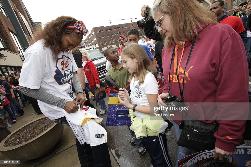 Tamika Catchings of the indiana Fever signs some autographs during the Indiana Fever's WNBA Championship celebration on October 23, 2012 at Bankers Life Fieldhouse in Indianapolis, Indiana.