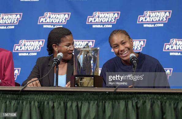 Tamika Catchings of the Indiana Fever smiles after Renee Brown Vice President of Player Personel for the WNBA annouced Catchings as the Rookie of the...