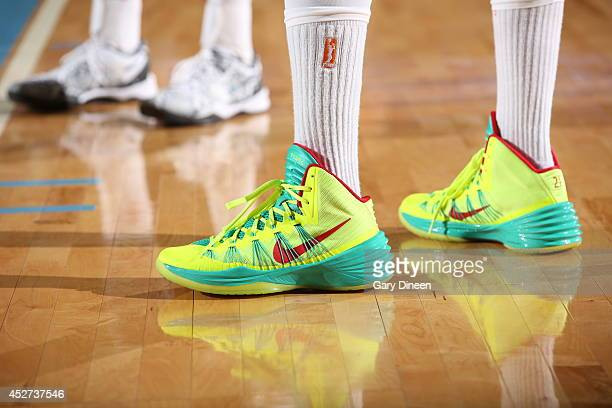 Tamika Catchings of the Indiana Fever sneakers are shown during the game against the Chicago Sky on July 22 2014 at the Allstate Arena in Rosemont...