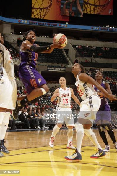 Tamika Catchings of the Indiana Fever watches as Alexis Hornbuckle of the Phoenix Mercury score at Banker's Life Fieldhouse on September 9 2012 in...