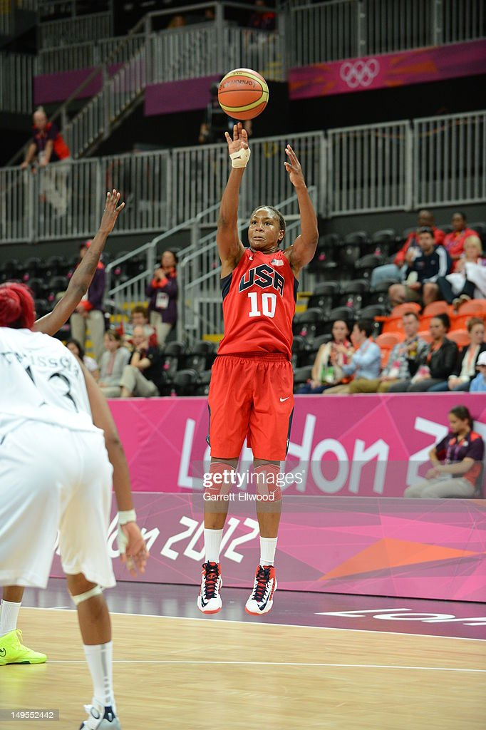 <a gi-track='captionPersonalityLinkClicked' href=/galleries/search?phrase=Tamika+Catchings&family=editorial&specificpeople=202220 ng-click='$event.stopPropagation()'>Tamika Catchings</a> #10 of the United States shoots against Angola at the Olympic Park Basketball Arena during the London Olympic Games on July 30, 2012 in London, England.
