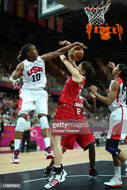 Tamika Catchings of United States blocks a shot in the Women's Basketball Preliminary Round match between the United States and Turkey on Day 5 of...