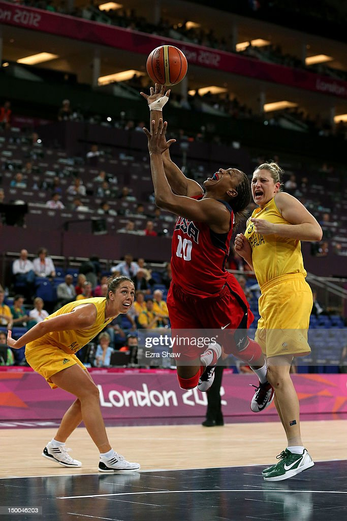 Tamika Catchings #10 of United States drives for a shot attempt against Jenna O'Hea #4 and Suzy Batkovic (R) #8 of Australia during the first half of the Women's Basketball semifinal on Day 13 of the London 2012 Olympics Games at North Greenwich Arena on August 9, 2012 in London, England.
