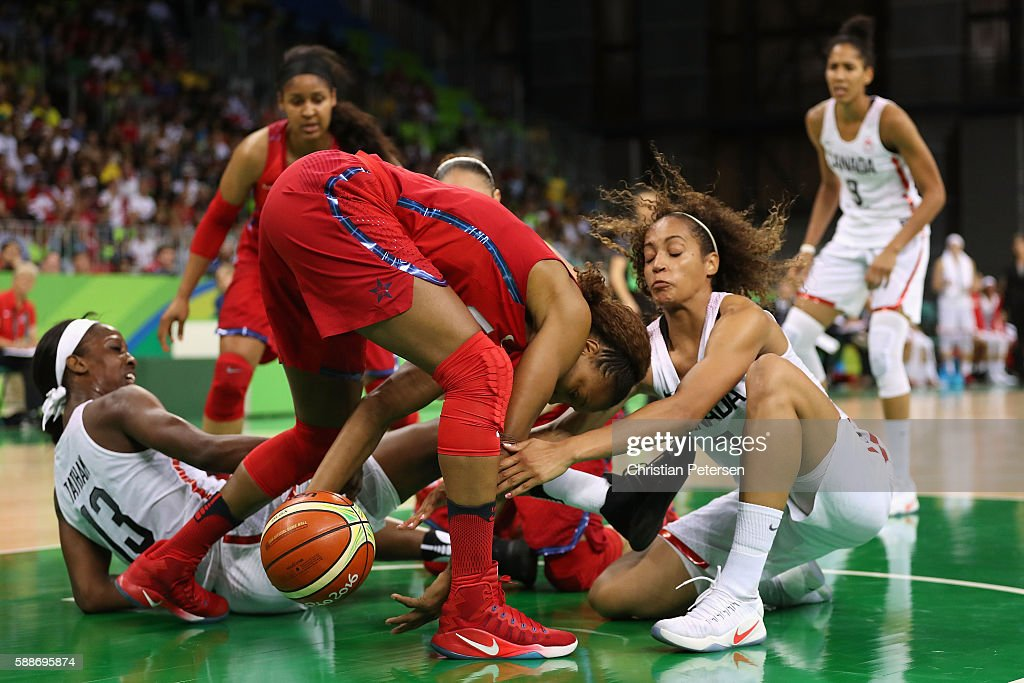 Tamika Catchings #10 of United States grabs a loose ball against Tamara Tatham #13 and Nayo Raincock-Ekunwe #7 of Canada during the women's basketball game on Day 7 of the Rio 2016 Olympic Games at the Youth Arena on August 12, 2016 in Rio de Janeiro, Brazil.