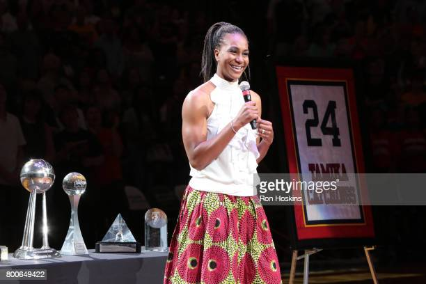 Tamika Catchings the WNBA champion and fourtime Olympic gold medalist retires her No 24 jersey during halftime of the game between the Los Angeles...