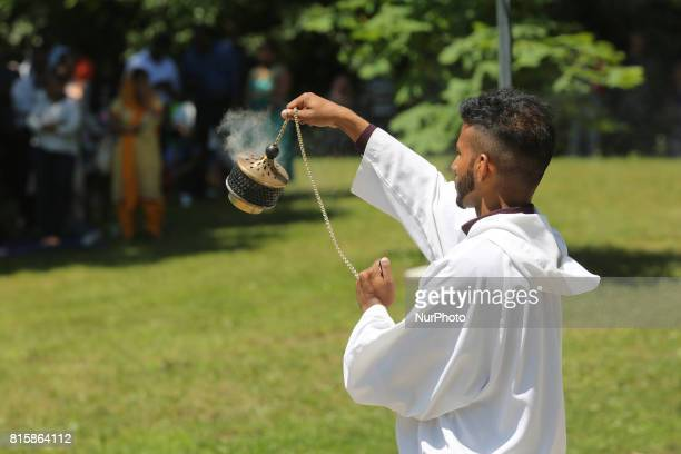 Tamil Catholic man circles the altar with incense during the Feast of Our Lady of Madhu as part of a special pilgrimage in Ontario Canada on July 15...
