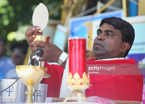 Tamil Catholic priests perform communion during the Feast of Our Lady of Madhu as part of a special pilgrimage in Ontario Canada on July 15 2017