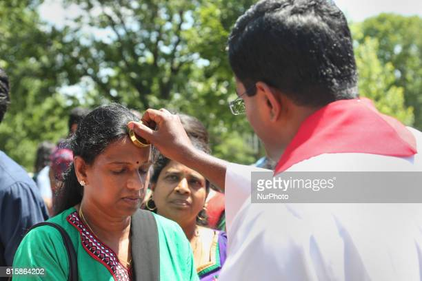 Tamil Catholic priests perform special blessings using a holy relic during the Feast of Our Lady of Madhu in Ontario Canada on July 15 2017