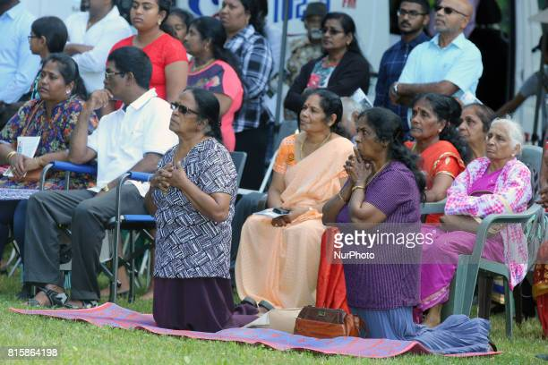 Tamil Catholics kneel and listen as a priest recites prayers during the Feast of Our Lady of Madhu as part of a special pilgrimage in Ontario Canada...
