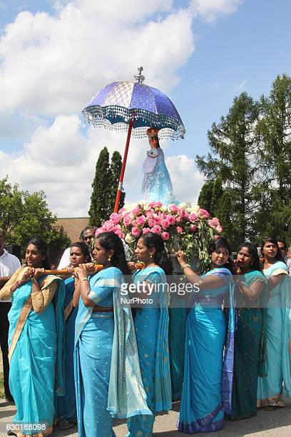 Tamil Catholics take part in the religious procession during the Feast of Our Lady Madu outside a Catholic Church in Ontario Canada on August 20 2016...