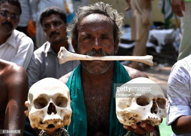 Tamil farmers during their protest with skulls and bones for loan waiver and droughtrelief package at Jantar Mantar on July 18 2017 in New Delhi...