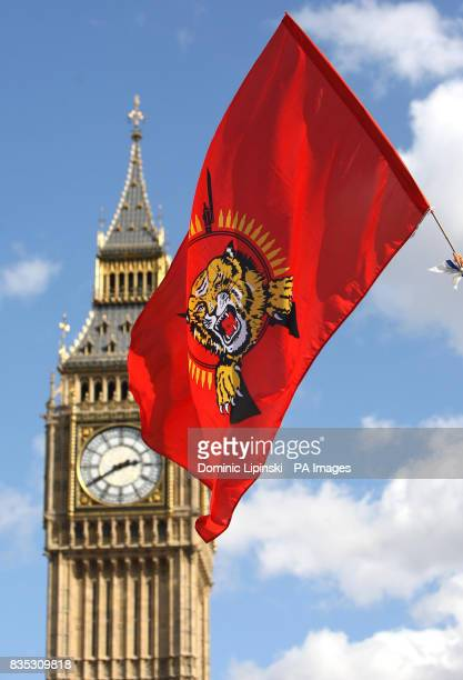A Tamil flag is waved as demonstrators take part in a protest to call for an immediate ceasefire in Sri Lanka at Parliament Square Westminster London