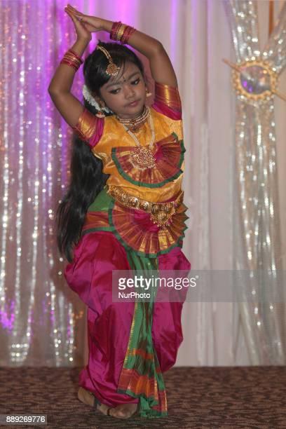 Tamil girl performs a traditional Bharatnatyam dance during the V Rambaikulam Girls Maha Vidyalayam Old Students Association Christmas gala...