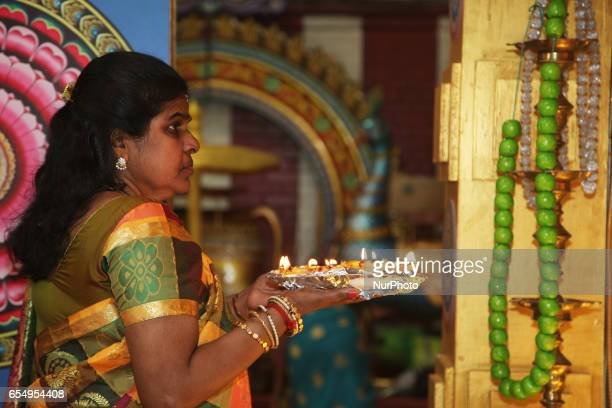 Tamil Hindu devotee takes part in prayers during the Mahotsava Festival at a Hindu temple in Ontario Canada