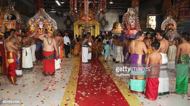 Tamil Hindu devotees carry the deities around the temple during a religious procession celebrating the Mahotsava Festival at a Hindu temple in...