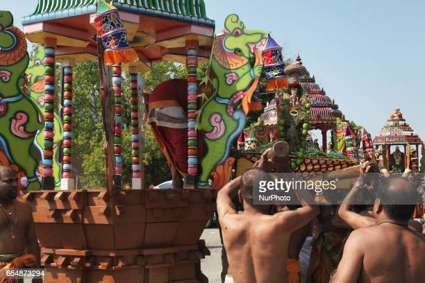 Tamil Hindu devotees carry the idol of Lord Ganesh from the chariot back to the temple during the Mahotsava Festival at a Hindu temple in Ontario...