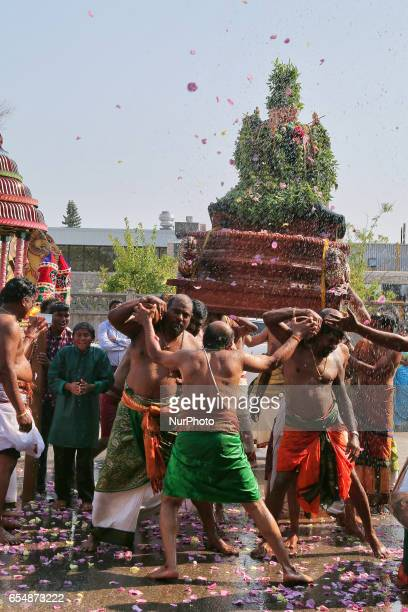 Tamil Hindu devotees carry the idol of Lord Murugan during a religious procession celebrating the Mahotsava Festival at a Hindu temple in Ontario...