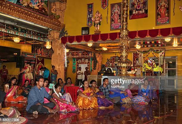 Tamil Hindu devotees listen to devotional songs honouring the Goddess Durka during the Valvettithurai Athivairawar Festival at a Hindu temple in...