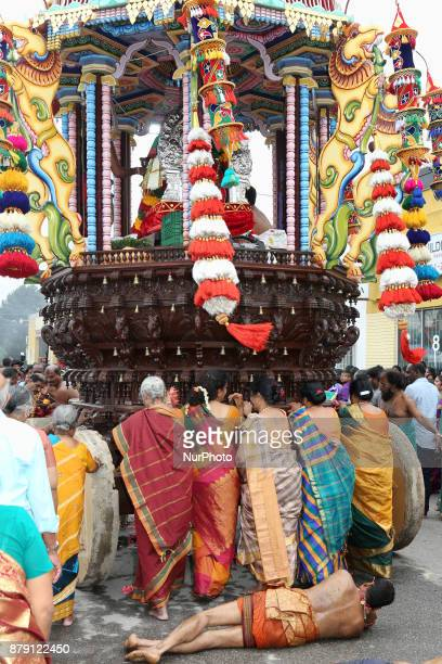 Tamil Hindu devotees perform the Angapradakshinam ritual during the Vinayagar Ther Thiruvizha Festival in Ontario Canada The Angapradakshinam ritual...