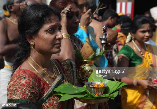Tamil Hindu devotees take part in prayers during the Mahotsava Festival at a Hindu temple in Ontario Canada