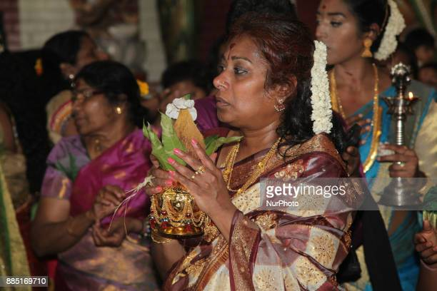 Tamil Hindu devotees take part in special prayers during the Mahotsava Festival at a Hindu temple in Ontario Canada