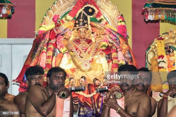 Tamil Hindu devotees take part in special prayers during the Sapara Thiruvilaa Puja at the Shri Muththumaari Amman Hindu Temple in Ontario Canada