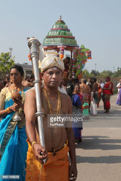 Tamil Hindu devotees take part in the religious chariot procession during the Mahotsava Festival at a Hindu temple in Ontario Canada