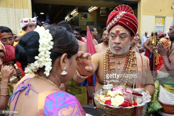 Tamil Hindu priest blesses a devotee during the Vinayagar Ther Thiruvizha Festival in Ontario Canada This festival is part of the 15 day long...