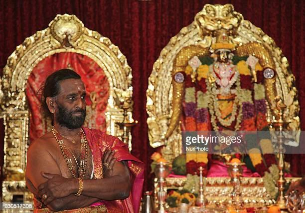 Tamil Hindu priest in the innersanctum with the main temple deities during the Valvettithurai Athivairawar Festival at a Hindu Temple in Toronto...