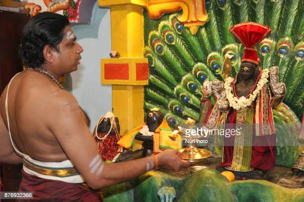 Tamil Hindu priest performs prayers honoring Lord Murugan during the Thaipusam Festival at a Tamil Hindu temple in Ontario Canada The festival...