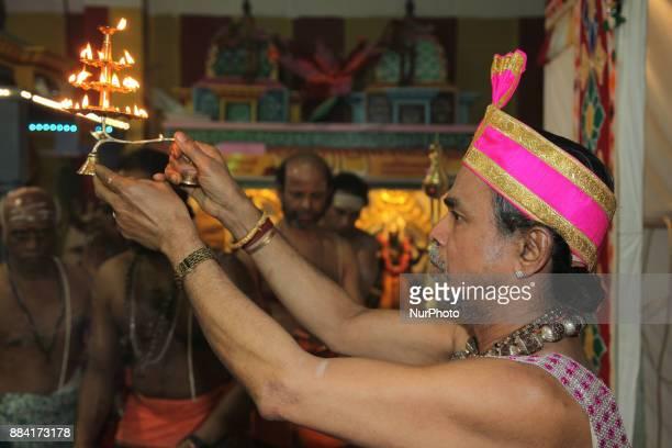 Tamil Hindu priest performs special prayers during the Sapara Thiruvilaa Puja at the Shri Muththumaari Amman Hindu Temple in Ontario Canada