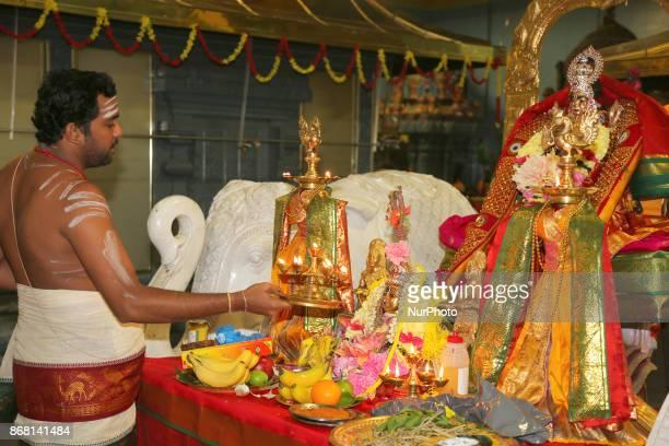 Tamil Hindu priest performs special prayers during Varalaxmi Pooja at a Tamil Hindu temple in Toronto Ontario Canada Varalaxmi Pooja is performed by...