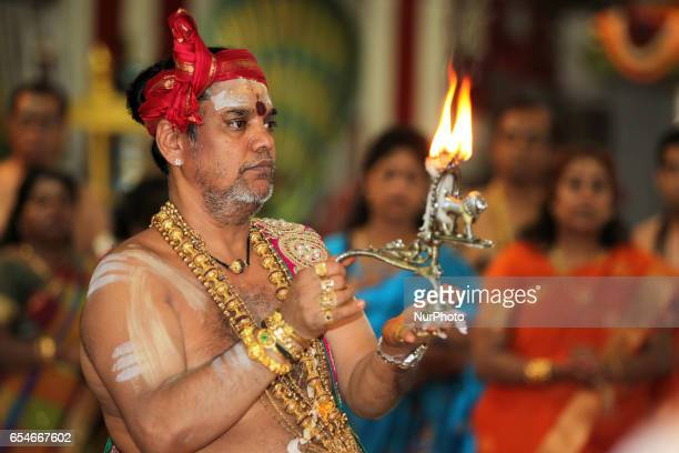 Tamil Hindu priest performs special prayers honouring Lord Murugan during the Mahotsava Festival at a Hindu temple in Ontario Canada