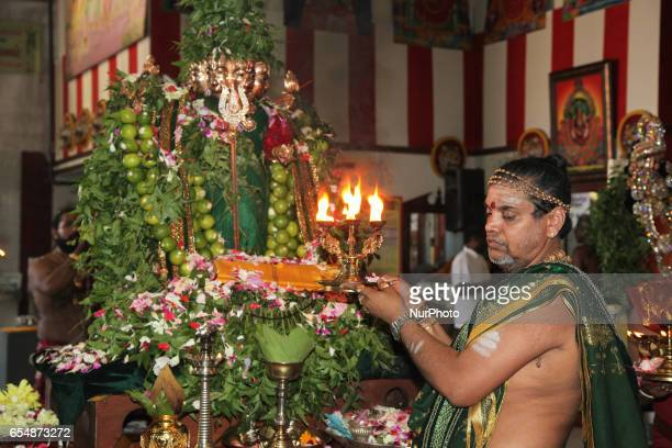 Tamil Hindu priest performs special prayers honouring Lord Murugan during the Mahotsava Festival at a Hindu temple in Ontario Canada The Idol of Lord...