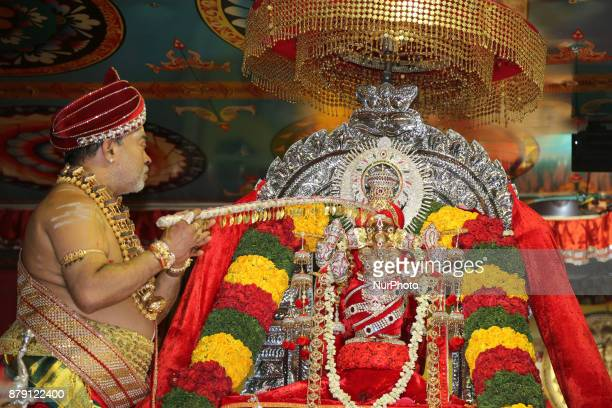 Tamil Hindu priest performs special prayers honouring Lord Vinayagar during the Vinayagar Ther Thiruvizha Festival in Ontario Canada This festival is...