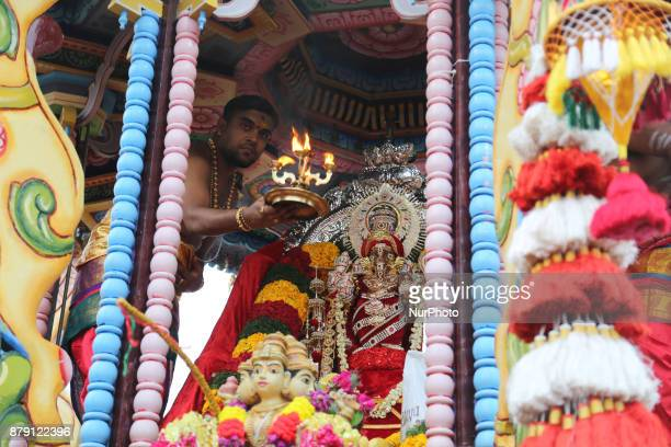 Tamil Hindu priest performs special prayers inside the large wooden chariot carrying the idol of Lord Vinayagar during the Vinayagar Ther Thiruvizha...