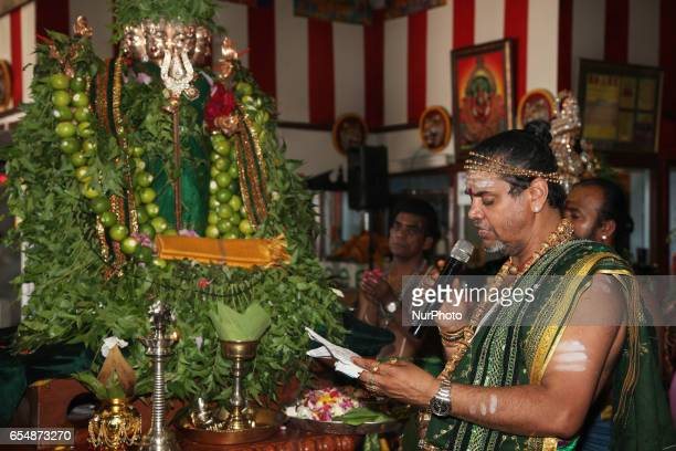 Tamil Hindu priest recites special prayers honouring Lord Murugan during the Mahotsava Festival at a Hindu temple in Ontario Canada The idol of Lord...