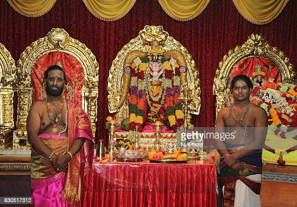 Tamil Hindu priests in the innersanctum with the main temple deities during the Valvettithurai Athivairawar Festival at a Hindu Temple in Toronto...