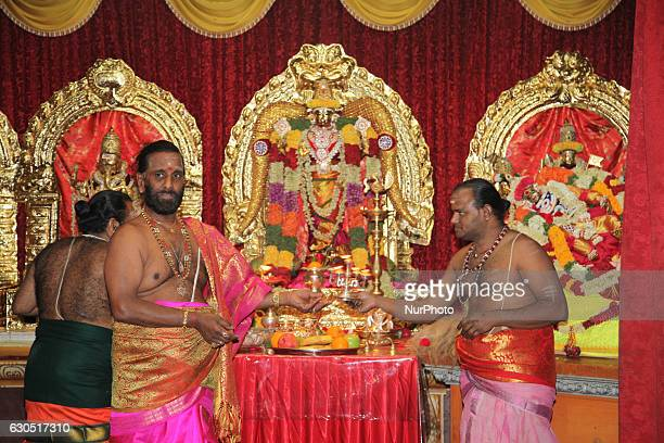 Tamil Hindu priests perform special prayers for the Goddess Durka during the Valvettithurai Athivairawar Festival at a Hindu Temple in Toronto...