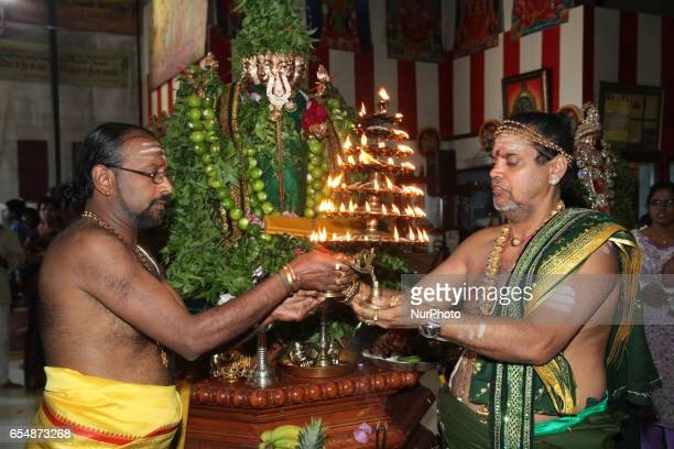 Tamil Hindu priests perform special prayers honouring Lord Murugan during the Mahotsava Festival at a Hindu temple in Ontario Canada The Idol of Lord...
