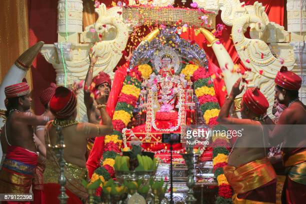 Tamil Hindu priests perform special prayers honouring Lord Vinayagar as flower petals are thrown during the Vinayagar Ther Thiruvizha Festival in...