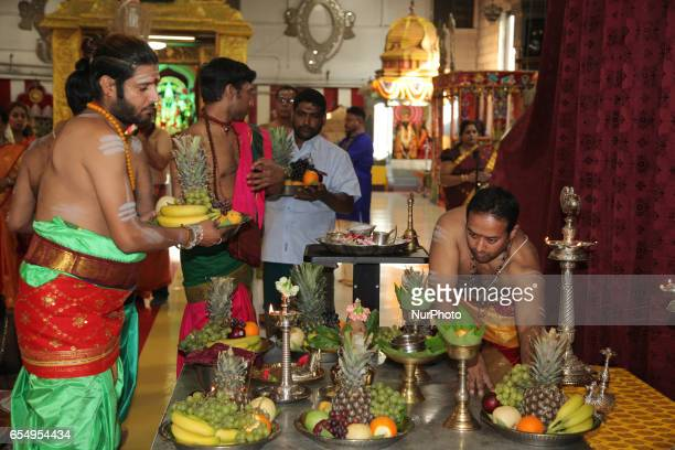 Tamil Hindu priests prepare trays of offerings for Lord Murugan during the Mahotsava Festival at a Hindu temple in Ontario Canada
