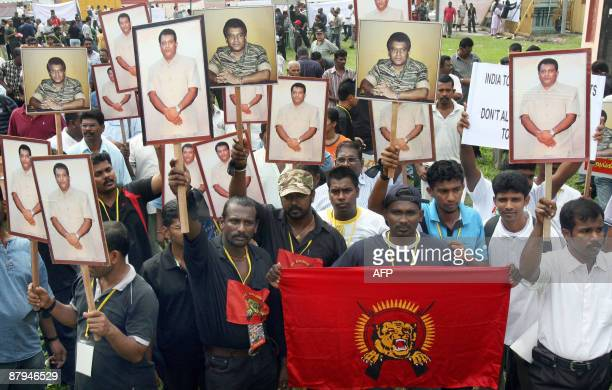 Tamil Malaysians carry posters of killed Tamil Tiger rebel leader Velupillai Prabhakaran during a demonstration outside the Batu Caves Temple near...
