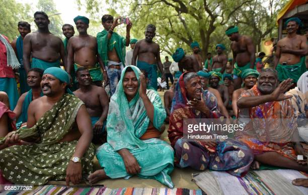 Tamil Nadu farmers wearing sari during a protest for demanding drought compensation package on April 14 2017 in New Delhi India Farmers from Tamil...
