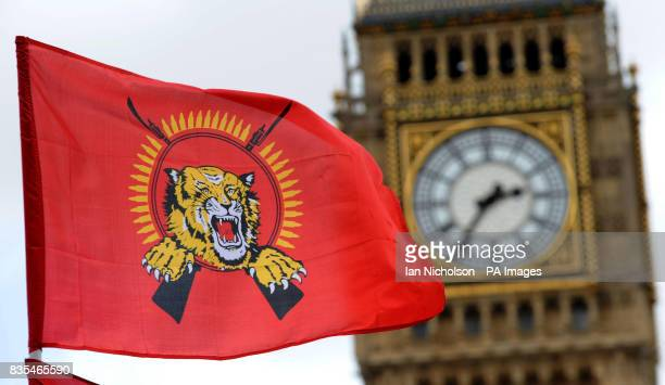 A Tamil Tiger flag flies in front of the Houses of Parliament as Tamil supporters demonstrate on Parliament Square following news that the leader of...