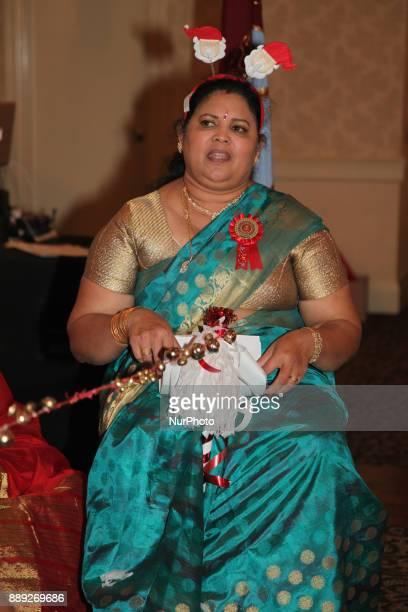 Tamil woman singing Christmas songs while using jingle bells during the V Rambaikulam Girls Maha Vidyalayam Old Students Association Christmas gala...
